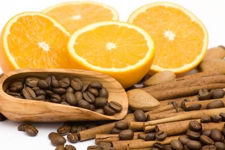 orange, coffee, cinnamon and almonds photo