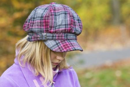 Autumn portrait of a lovely little girl Standard-Bild