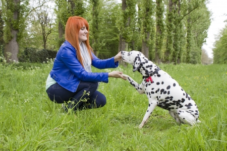 young woman and her dog  Stock Photo - 15072979