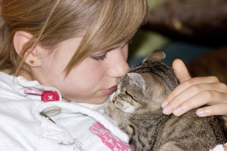 Portrait of child with kitten photo