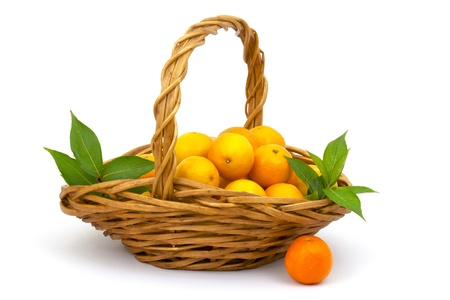 tangerines in a basket on white background  photo