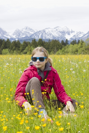 portrait of a girl against the panorama of the Alps photo