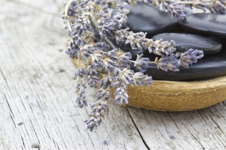massage stones and dried lavender photo