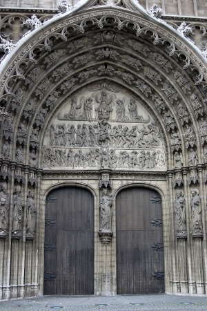 Bronze door entry to famous Vrouwekathedraal - Cathedral of our Lady in Antwerp photo