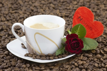 cup of coffee, red roses and heart photo