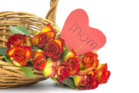 red and yellow roses in a basket photo