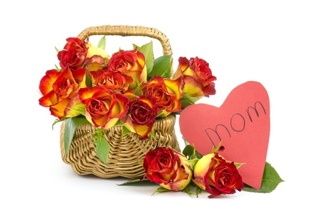 red and yellow roses in a basket and heart photo