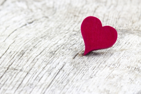 red heart on wooden background Stock Photo - 17333516