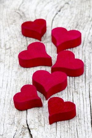 red hearts on old wooden background Stock Photo - 17960411