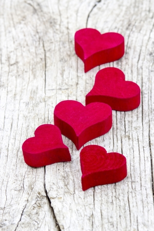 red hearts on old wooden background Stock Photo - 17960412