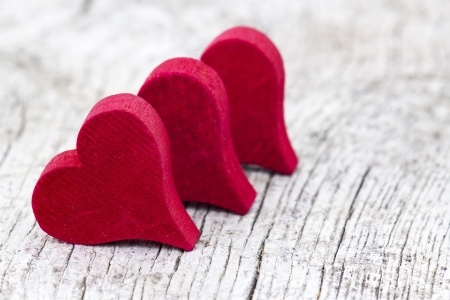 red hearts on old wooden background Stock Photo - 17960413
