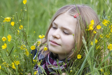 portrait of a girl with flowers on the meadow photo