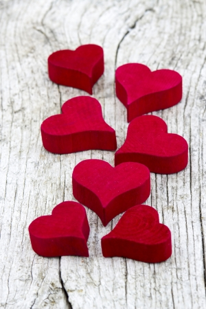 red hearts on old wooden background Stock Photo - 18879578