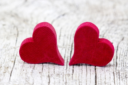 two red hearts on wooden background Stock Photo - 19094741