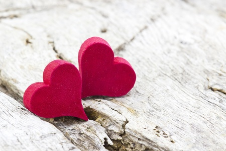 two red hearts on wooden background Stock Photo - 19363685