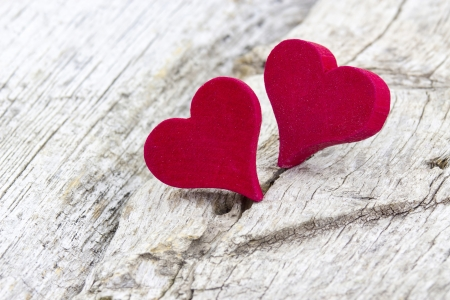 two red hearts on wooden background Stock Photo - 19363689