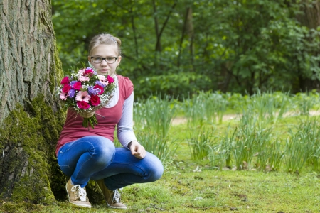 portrait of a cute young girl with flowers  photo