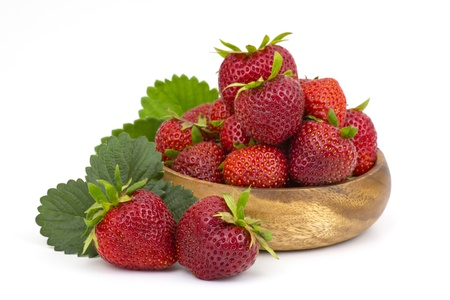 fresh strawberries in a bowl on white background photo