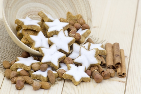 typical christmas cinnamon star cookies, nuts and cinnamon sticks photo
