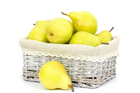fresh pears in a basket on white background photo