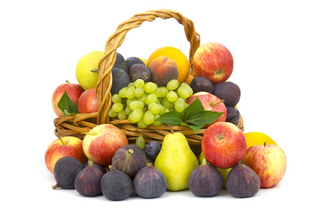 fresh fruits in a basket on white background photo