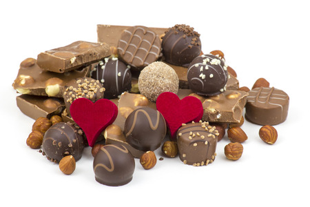 delicious chocolate and hearts on white background photo