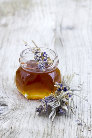 herbal honey with lavender flowers photo