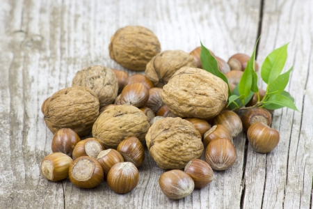 nuts on old wooden background photo