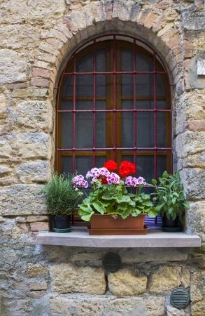 volterra: lovely tuscan window, Volterra, Italy Stock Photo