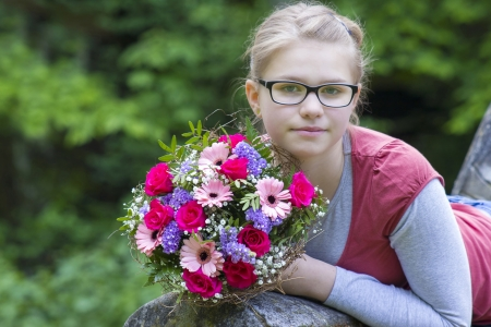 portrait of a beautiful young girl with flowers photo