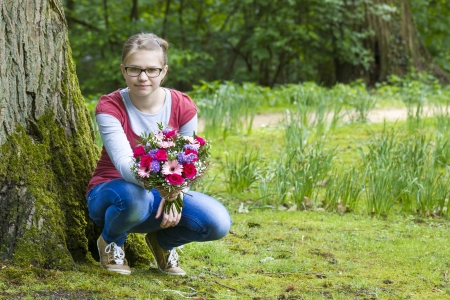 cute young girl with flowers - gift for the mother photo