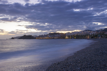 Playa De La Caletilla at sunset, Almunecar, Andalusia, Spain  photo