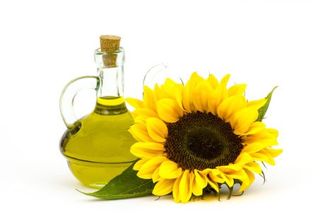 sunflower oil and sunflowers isolated on white background Standard-Bild