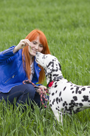 A beautiful woman and her dog photo