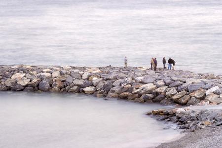 groyne: Fisher men on the stone groyne