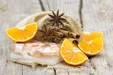 glycerin soap: aromatic glycerin soap, orange and spices on wooden background