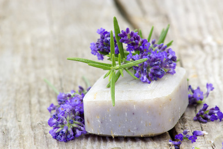natural soap: bar of natural soap, lavender flowers and rosemary