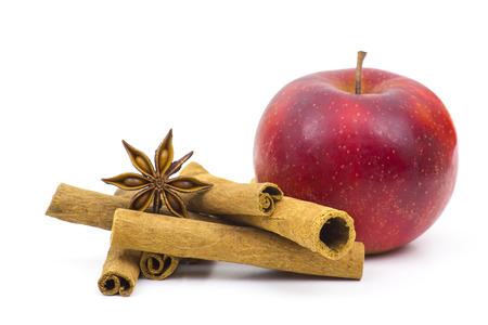 cinnamon sticks: apple, cinnamon sticks and anise on white