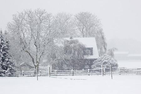 snowfall: snowfall in the village - winter landscape Stock Photo