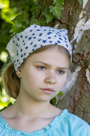 european white birch: Portrait of young girl standing near tree at summer green park Stock Photo