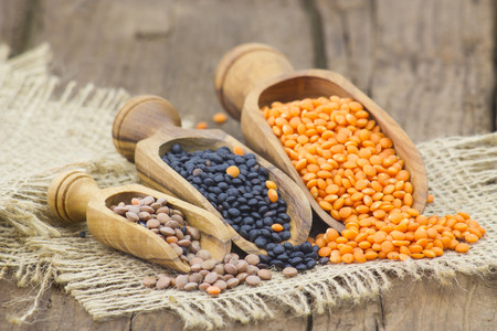 lentils: wooden scoops with lentils Stock Photo