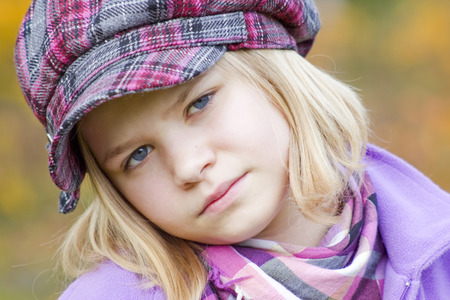 Autumn portrait of a lovely little girl photo
