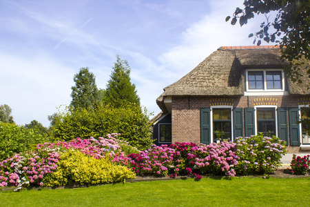 county side: GIETHOORN, NETHERLANDS -typical dutch county side of houses and gardens