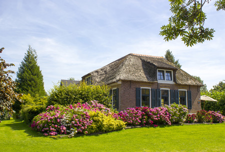 dutch typical: GIETHOORN, NETHERLANDS -typical dutch county side of houses and gardens