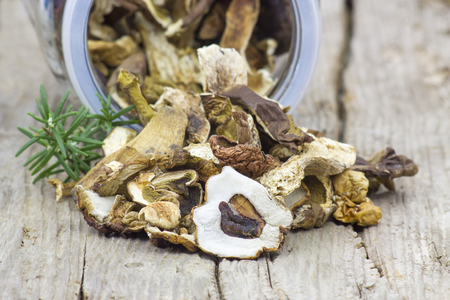 fungous: dried mushrooms on wooden background