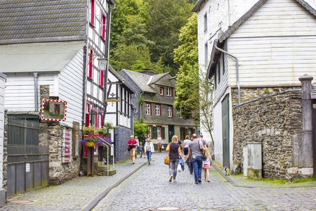 remained: MONSCHAU, GERMANY - JULY 30, 2016: small town Monschau with unidentified people. The historic town center has many half-timbered houses and narrow streets remained nearly unchanged for 300 years