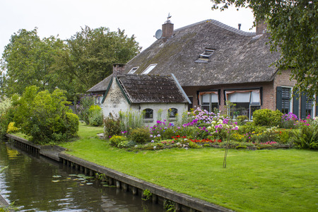 typical: GIETHOORN, NETHERLANDS -typical dutch county side of houses and gardens