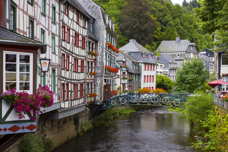MONSCHAU, GERMANY - JULY 30, 2016: small town Monschau in the Eifel region. The historic town center has many half-timbered houses and narrow streets remained nearly unchanged for 300 years Editorial