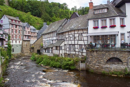 MONSCHAU, GERMANY - JULY 30, 2016: small town Monschau with unidentified people. The historic town center has many half-timbered houses and narrow streets remained nearly unchanged for 300 years