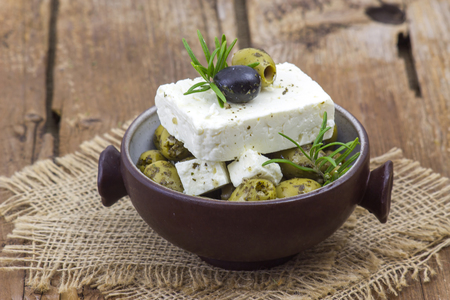 feta cheese and olives with herbs in olive oil Archivio Fotografico - 95573838